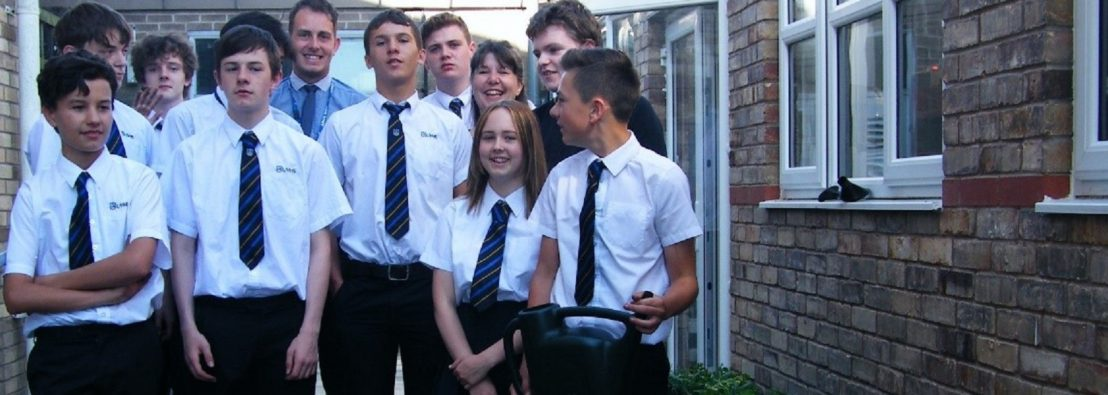 Students and teacher from Incredible Edible Ulverston next to their herb pots