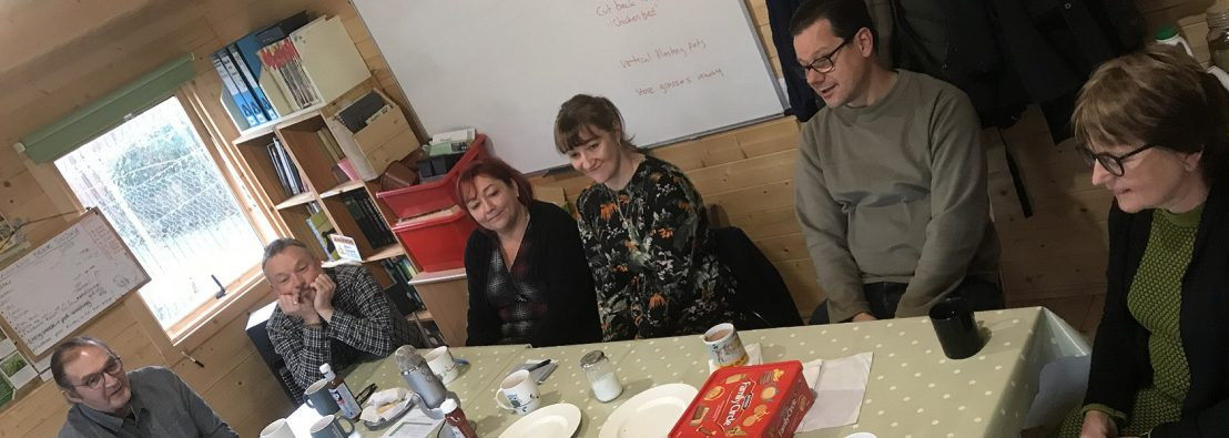 People sitting around a table sharing tea, biscuits and Incredible stories